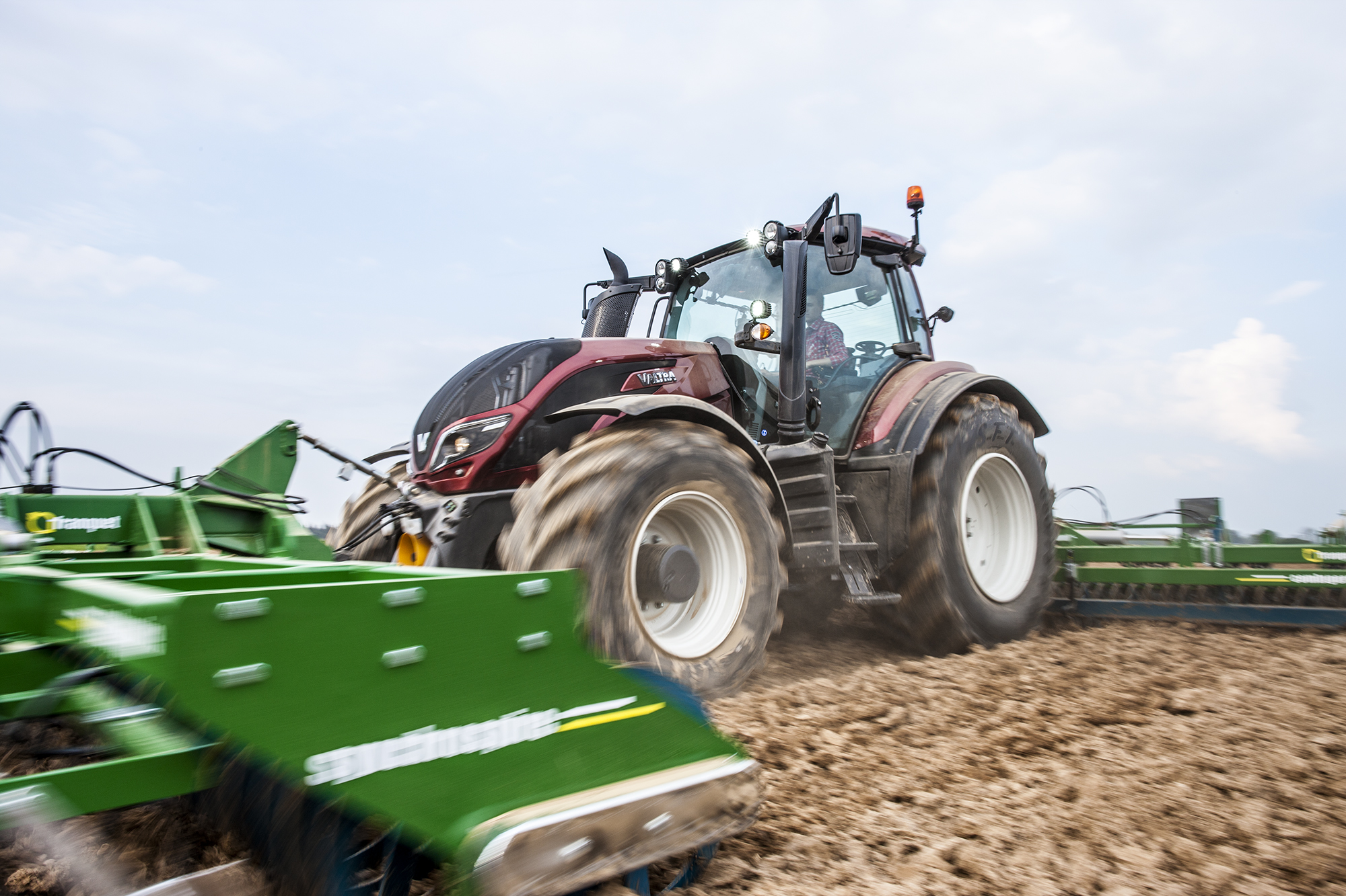 valtra t4 series tractor working on the field
